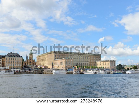 STOCKHOLM, SWEDEN - AUGUST 15, 2014. View of the Royal Palace from bay. The Royal Palace is one of the most famous point of interest - stock photo
