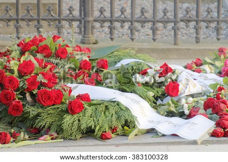 STOCKHOLM, SWEDEN - FEB 28, 2016: Lots of roses on the grave of the murdered prime minister Olof Palme on the memorial day 30 years after the murder. February 28, 2016, Stockholm, Sweden