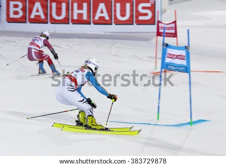 STOCKHOLM, SWEDEN - FEB 23, 2016: Maren Wiesler (GER) and competitor skiing at the FIS Alpine Ski World Cup - Men's and Woman's city event February 23, 2016, Stockholm, Sweden - stock photo