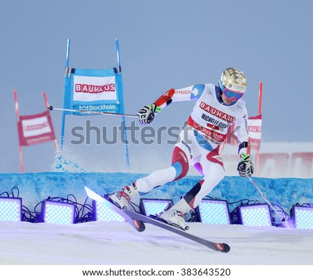 STOCKHOLM, SWEDEN - FEB 23, 2016: Skier Michelle Gisin (SUI) jumping at the FIS Alpine Ski World Cup - city event February 23, 2016, Stockholm, Sweden - stock photo