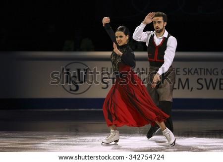 STOCKHOLM, SWEDEN - FEBRUARY 1, 2015: Sara HURTADO / Adria DIAZ of Spain perform during the Exhibition Gala at ISU European Figure Skating Championship in Globen Arena. - stock photo