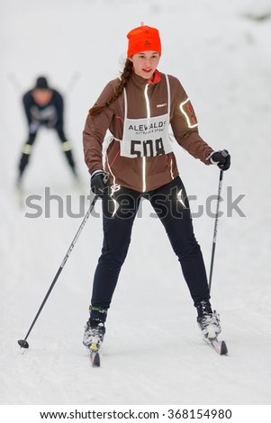 STOCKHOLM, SWEDEN - JAN 24, 2016: Female skier at the event Ski Marathon in nordic skiing classic style.