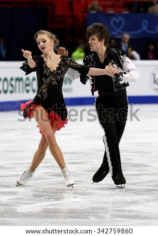 STOCKHOLM, SWEDEN - JANUARY 28, 2015: Alexandra STEPANOVA / Ivan BUKIN of Russia perform short dance at ISU European Figure Skating Championship in Globen Arena.