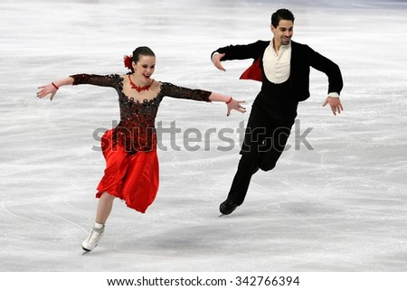 STOCKHOLM, SWEDEN - JANUARY 28, 2015: Anna CAPPELLINI / Luca LANOTTE of Italy perform short dance at ISU European Figure Skating Championship in Globen Arena. - stock photo