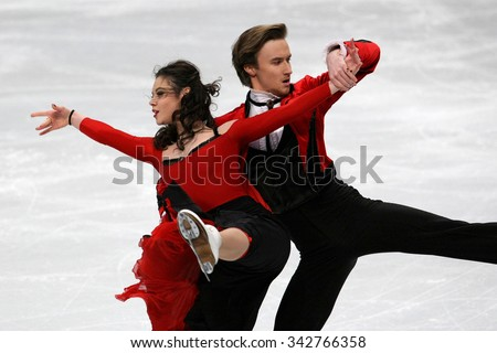 STOCKHOLM, SWEDEN - JANUARY 28, 2015: Elena ILINYKH / Ruslan ZHIGANSHIN of Russia perform short dance at ISU European Figure Skating Championship in Globen Arena. - stock photo