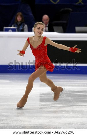 STOCKHOLM, SWEDEN - JANUARY 29, 2015: Elena RADIONOVA of Russia performs short program at ISU European Figure Skating Championship in Globen Arena. - stock photo