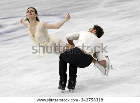 STOCKHOLM, SWEDEN - JANUARY 29, 2015: Gabriella PAPADAKIS / Guillaume CIZERON of France perform during ice dance free skating at ISU European Figure Skating Championship in Globen Arena. - stock photo