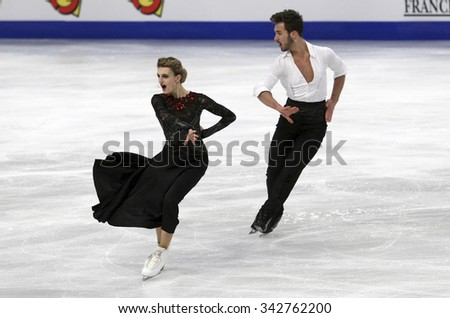 STOCKHOLM, SWEDEN - JANUARY 28, 2015: Gabriella PAPADAKIS / Guillaume CIZERON of France perform short dance at ISU European Figure Skating Championship in Globen Arena. - stock photo