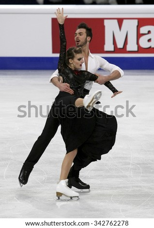 STOCKHOLM, SWEDEN - JANUARY 28, 2015: Gabriella PAPADAKIS / Guillaume CIZERON of France perform short dance at ISU European Figure Skating Championship in Globen Arena.