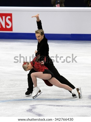 STOCKHOLM, SWEDEN - JANUARY 28, 2015: Penny COOMES / Nicholas BUCKLAND of Great Britain perform short dance at ISU European Figure Skating Championship in Globen Arena.