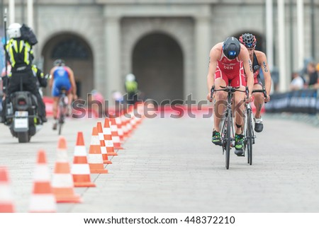 STOCKHOLM, SWEDEN - JULY 02, 2016: Andreas Shilling (DEN) in front of Xavier Grenier Talavera (CAN) in the cycling at the Mens ITU Triathlon event in Stockholm.