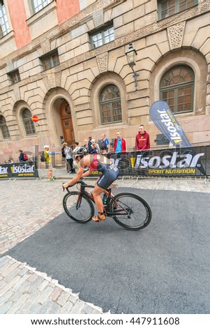 STOCKHOLM, SWEDEN - JULY 02, 2016: Flora Duffy (BER) cycling thru the old town at the Women ITU Triathlon event in Stockholm.