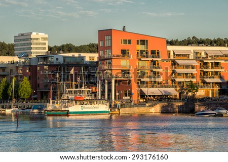 STOCKHOLM, SWEDEN - JULY 1: Summer evening at Hammarby lake city on July 1, 2015 in Stockholm. Hammarby lake city is a major residential redevelopment in an old industrial area of Stockholm. - stock photo