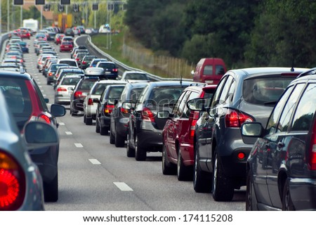 STOCKHOLM, SWEDEN - JULY 30, 2011: Typical scene during rush hour  in Stockholm. A traffic jam with rows of cars.  Shallow depth of field. - stock photo