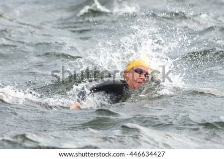 STOCKHOLM, SWEDEN - JULY 02, 2016: Warmup crawl in the water before the start at Women ITU Triathlon event in Stockholm.