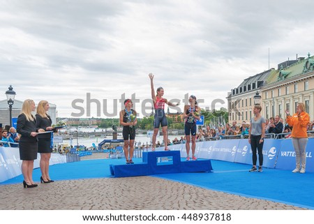 STOCKHOLM, SWEDEN - JULY 02, 2016: Winner Flora Duffy (NZL), second Andrea Hewitt (NZL) and third Helen Jenkins (GBR) at the podium and prize cermony at the Women ITU Triathlon event in Stockholm. - stock photo
