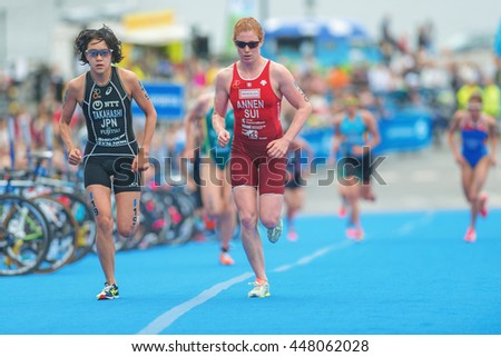 STOCKHOLM, SWEDEN - JULY 02, 2016: Yuko Takahashi and Jolanda Annen in the transition between cycling and running at the Women ITU Triathlon event in Stockholm.