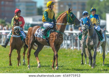 STOCKHOLM, SWEDEN - JUN 6, 2017: Jockey and racehorse at Nationaldagsgaloppen at Gardet.