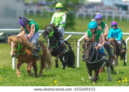 STOCKHOLM, SWEDEN - JUN 6, 2017: Ponys racing at full speed at Gardet. National day 6th of june.