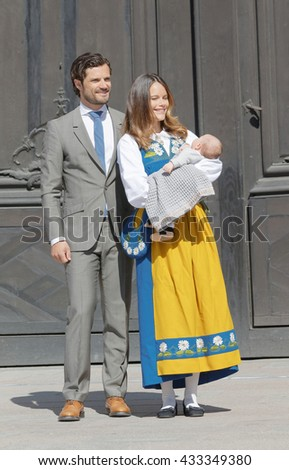 STOCKHOLM, SWEDEN - JUN 06, 2016: The swedish prince Carl Philip Bernadotte and princess Sofia Hellqvist holding the newborn baby Alexander in front of the royal castle during the swedish National day