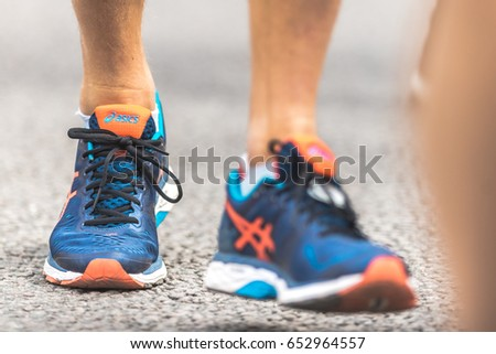 STOCKHOLM, SWEDEN - JUNE 3, 2017: Closeup of legs and feet at the Stockholm Marathon. About +13k started