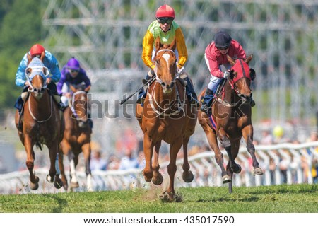 STOCKHOLM, SWEDEN - JUNE 6, 2016: Jockeys out of a curve at the Nationaldags Galoppen at Gardet. - stock photo