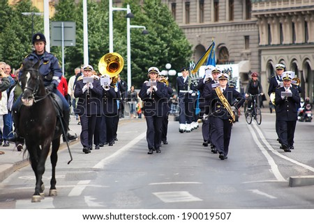 STOCKHOLM, SWEDEN - JUNE 13, 2008: Musicians of the Military band marching from the Kungstradgatan street to the Royal Palace during the Changing of the Royal Guards Ceremony.