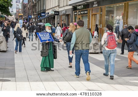 STOCKHOLM, SWEDEN. June 8, 2015. Muslim cleric collecting charity from passersby in the central shopping area of Stockholm, Vasagatan street.