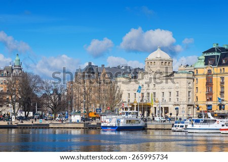 STOCKHOLM, SWEDEN - MAR 31: Dramaten theater and Nybrokajen during a sunny day, March 31, 2015 in Stockholm, Sweden. - stock photo