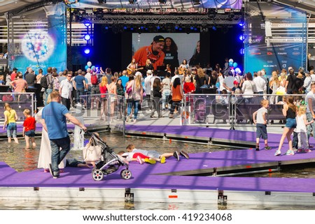 STOCKHOLM, SWEDEN - MAY 8, 2016: Eurovision village with music and warm feelings in Kungstradgarden in Stockholm during the Eurovision Song Contest week. - stock photo