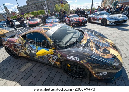 STOCKHOLM, SWEDEN - MAY 23: Gumball 3000 cars at display on the streets of Stockholm on May 23, 2015. People at the streets admiring the exotic cars at display before the start of the 2015 event. - stock photo