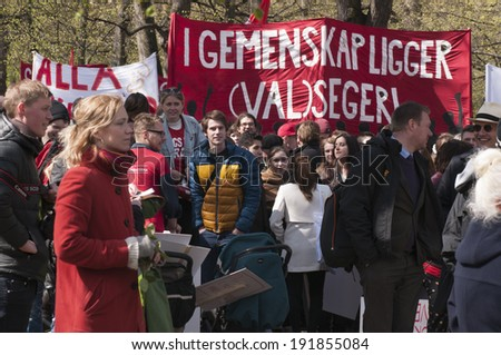 STOCKHOLM, SWEDEN - MAY 1: Parade participants are waiting for the event to start to celebrate the International Workers Day on May 1, 2014 in Humlegarden, Stockholm, Sweden. - stock photo