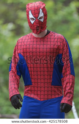 STOCKHOLM, SWEDEN - MAY 14, 2016 Spiderman at Tough Viking obstacle course around Stockholm Stadion. - stock photo
