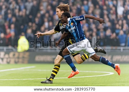 STOCKHOLM, SWEDEN - MAY 25: Two players chasing the ball in the soccer game DIF vs AIK at Tele2 arena on May 25, 2015.  - stock photo