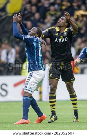 STOCKHOLM, SWEDEN - MAY 25: Two players reaches for the ball in the game of DIF against AIK at Tele2 arena on May 25, 2015. Tele2 arena is a new multipurpose arena in Stockholm.