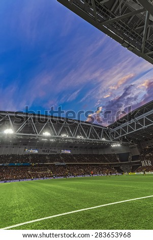 STOCKHOLM, SWEDEN - MAY 25: View of Tele2 arena during the soccer game between DIF and AIK at the evening with dramatic sky on May 25, 2015. Final result 2-2.