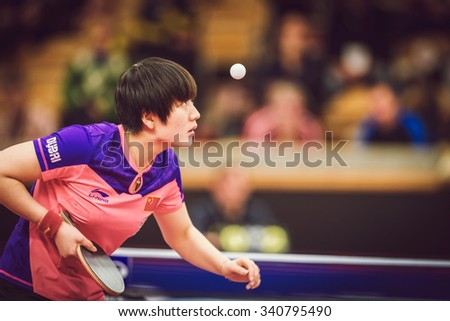 STOCKHOLM, SWEDEN - NOV 15, 2015: Final match in double between Ye, Yihan (SIN) and Meng, Zi (CHI) at the table tennis tournament SOC at the arena Eriksdalshallen. - stock photo
