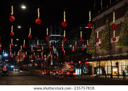 STOCKHOLM, SWEDEN - 30 NOVEMBER: Night view at a christmas decorated street downtown in Stockholm City, the capital of Sweden. Photo taken on 30 November 2014 at City of Stockholm, Sweden. - stock photo