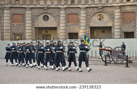 STOCKHOLM, SWEDEN - 28 NOVEMBER, 2014: Removal of the national flag at the changing of the guard at the Royal Palace in Stockholm, Sweden.