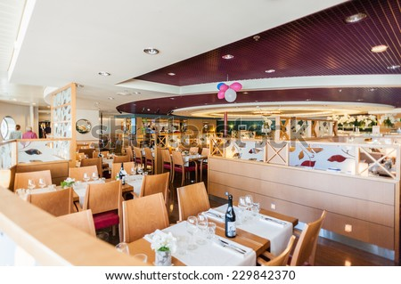 STOCKHOLM, SWEDEN - SEP 7, 2014: Restaurant at the Cruiseferry of the Estonian company Tallink. It is one of the largest passenger and cargo shipping companies in the Baltic Sea region - stock photo