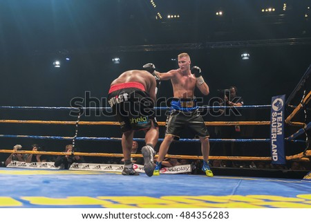STOCKHOLM, SWEDEN - SEPT 10, 2016: Match between Otto Wallin (SWE) vs Osbourne Machimana (RSA) in heavyweight at The winner takes it all event in boxing. Winner Otto Wallin