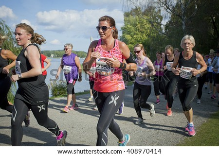 STOCKHOLM, SWEDEN - SEPT, 6 2014. Tjejmilen, a race for women in Stockholm. - stock photo