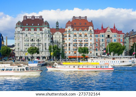 STOCKHOLM, SWEDEN - SEPTEMBER 08, 2010: Scene of boat traffic, buildings, local and tourists in Stockholm, Sweden - stock photo
