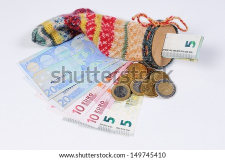 Stocking for saving with Euro bills and Euro Coins - stock photo