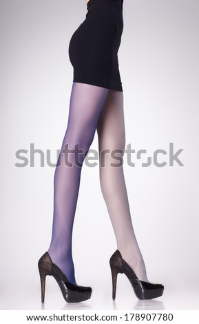 stockings on sexy woman legs isolated on grey