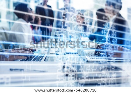 Stocks and shares against business people working on laptop