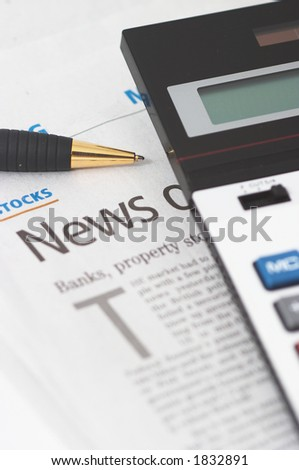 Stocks News, pen, calculator, banks, property headlines, shallow depth of field, vertical orientation - stock photo