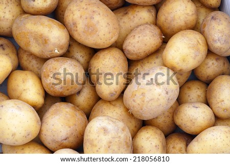 stocks, potatoes background beige brown - stock photo
