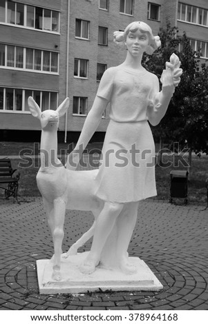 STOLIN, BELARUS - JULY 29, 2015: Sculpture of a woman with a deer on street of Stolin town. Black and white.