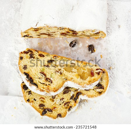 Stollen on a white parchment paper - stock photo